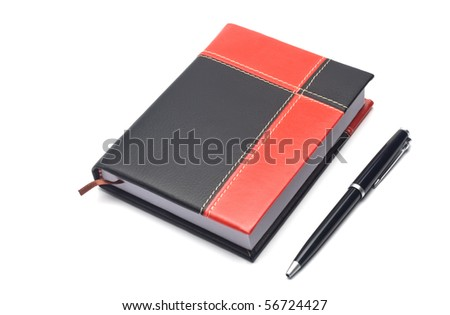 notepad in the red-black cover and pen  isolated on white background