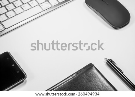 Notepad, keyboard, mouse and cell phone on white background - stock photo