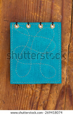 notepad on a wooden surface - stock photo