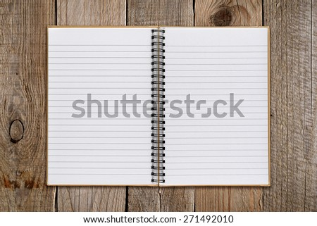 Notepad on old wooden background - stock photo