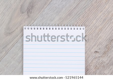 Notepad on wooden surface