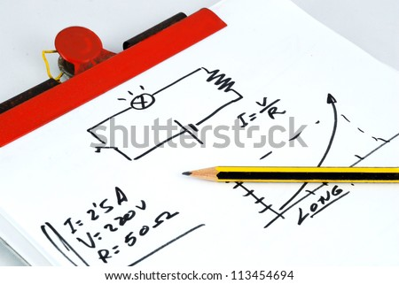 Notepad, pencil and a little schematic of Ohms law - stock photo