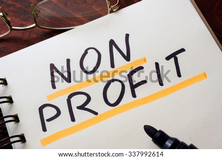 Notepad with non profit   on a table. Business concept. - stock photo