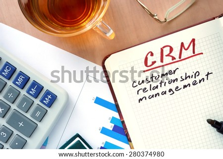 Notepad with words CRM customer relationship management  concept and marker.