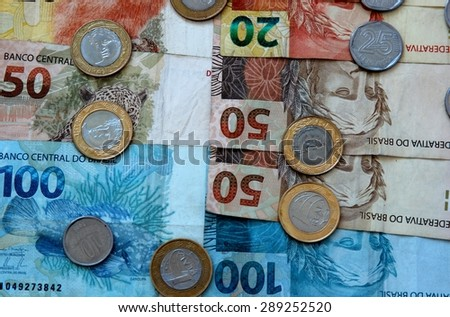 Notes and coins real money Brazil - stock photo