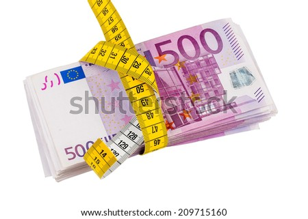 notes and tape measure, symbolic photo for austerity measures, fiscal consolidation and controlling
