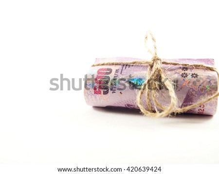 Notes money rope ribbon by brown string on white background, money collection concept  - stock photo
