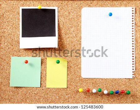 Notes paper and photo card on wooden background - stock photo