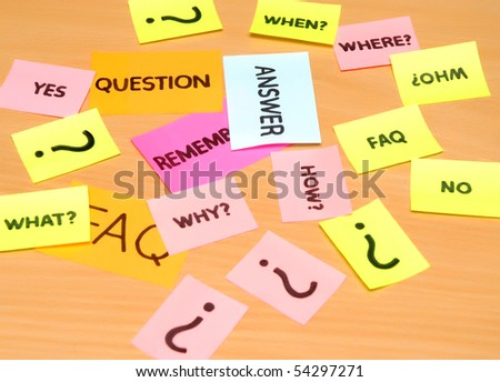 notes with faq over wooden desk background - stock photo