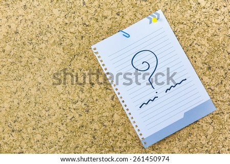 notes with question marks - stock photo