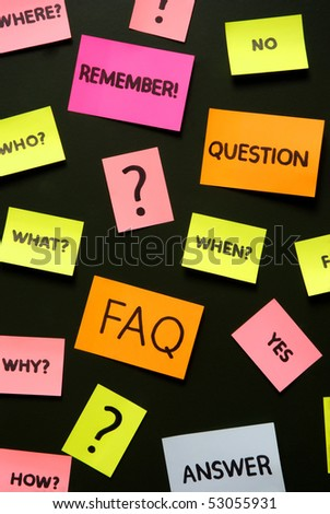 notes with questions and faq over school green board - stock photo