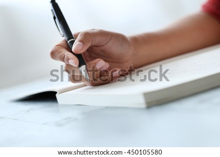 Notes. Woman holding a pen
