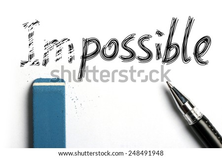 Nothing is Impossible Concept with blue eraser and black ball pen aside. - stock photo