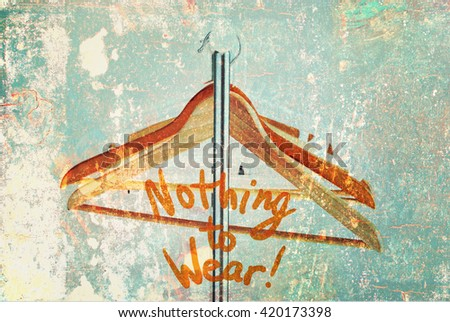 Nothing To Wear Design Concept Wooden Coat Hanger Open Cloth Rail Grey Wall Shabby Vintage Effect  - stock photo
