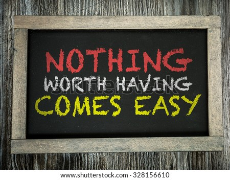 Nothing Worth Having Comes Easy written on chalkboard - stock photo