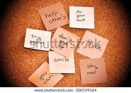Notice cork board with many sticky note pads - stock photo