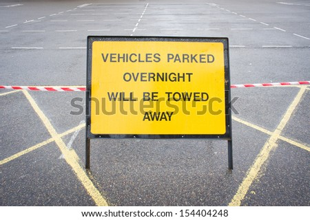 Notice in a car park forbidding overnight parking - stock photo