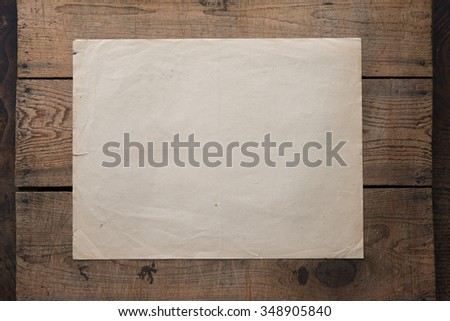 Notice, or Sheet of paper posted on a old wooden wall or bulletin board. Low key. - stock photo