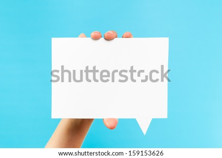 Notification speech bubble concept. White square blank bubble speech on blue background.
