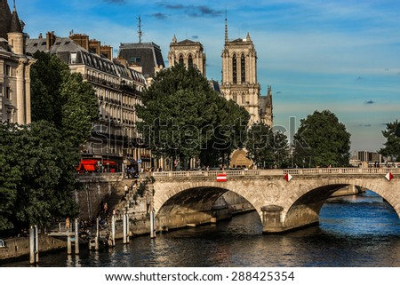 Notre Dam and the Seine River at sunset. Paris, France. - stock photo