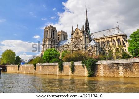 Notre Dame by the seine river, Paris, France - stock photo