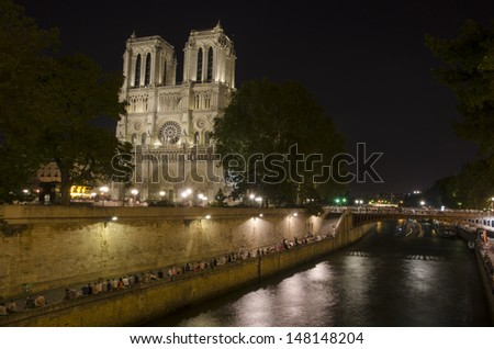 Notre dame cathedral at night, Paris, France - stock photo
