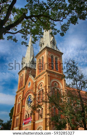 Notre-Dame Cathedral Basilica of Saigon in Ho Chi Minh City (Vietnam) against a blue sky