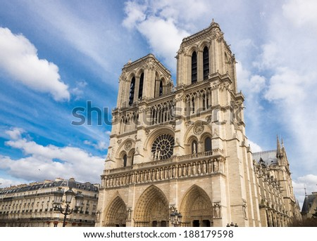 Notre-Dame Cathedral in Paris, facade and spectacular sky, France