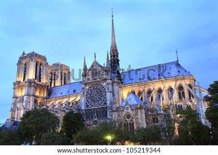 Notre Dame Cathedral in Paris France at dusk - stock photo
