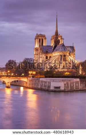 Notre Dame cathedral in Paris, France, at dusk.