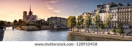 Notre Dame cathedral on Ile de la Cite in Paris, France seen from the Tournelle Bridge over River Seine. Part of Saint Louis Island on the right - stock photo