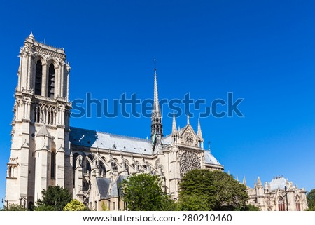 Notre Dame Cathedral onthe river side of Seine in Paris, France, which is widely considered to be one of the finest examples of French Gothic architecture - stock photo