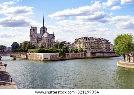 Notre Dame Cathedral with Paris cityscape, in Paris, France - stock photo