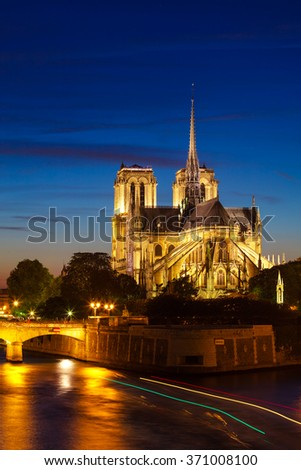 Notre-Dame de Paris at night, also known as Notre-Dame Cathedral - stock photo