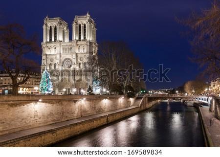 Notre Dame de Paris at night, France. - stock photo