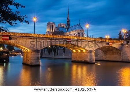 Notre Dame de Paris Cathedral and Seine River in the Evening, Paris, France - stock photo