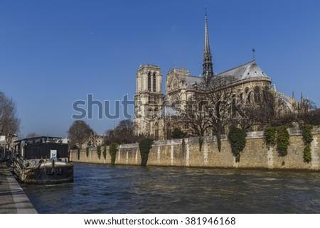 Notre dame de Paris Cathedral at the Seine river side - stock photo