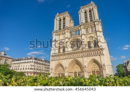 Notre-Dame de Paris Cathedral main facade in sunny summer day, France.