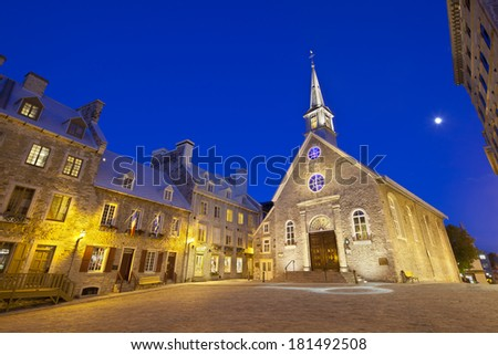 Notre-Dame-des-Victoires at Place Royale in Quebec City, Canada with its old buildings - stock photo