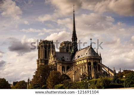Notre Dame of Paris arches and structure at sunrise light - stock photo