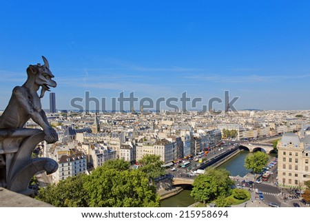 Notre Dame of Paris: Famous Chimera, demon, overlooking the Eiffel Tower at a summer day
