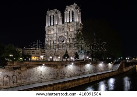 notre dame paris cathedral dome at night - stock photo