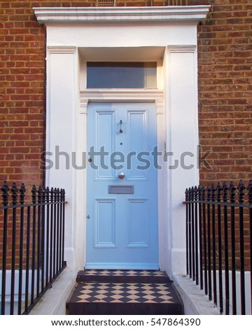 Notting hill, London, colorful entrance light blue door