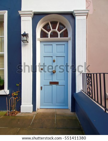 Notting hill, London, colorful entrance with light blue arched door