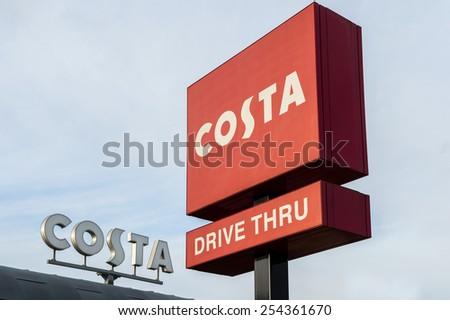 NOTTINGHAM, ENGLAND - FEBRUARY 20: Costa Coffee shop and drive-thru signage at Castle Marina Retail Park, Castle Bridge Road, Nottingham, NG7 1GX, United Kingdom. On 20TH February 2015. - stock photo