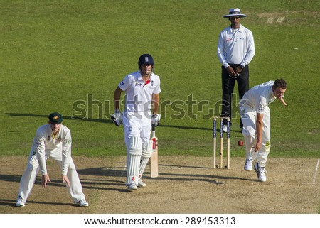 NOTTINGHAM, ENGLAND - July 11, 2013: Steven Smith Alastair Cook Aleem Dar look on as Peter Siddle bowls the ball during day two of the first Investec Ashes Test match at Trent Bridge Cricket Ground