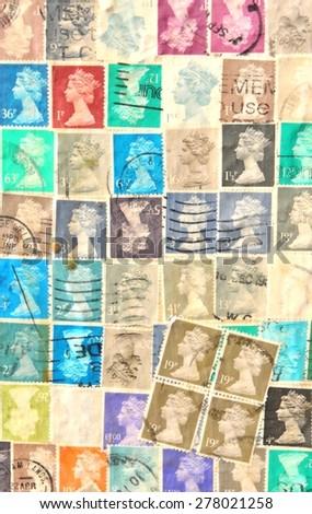 NOTTINGHAM, UK - APRIL 1, 2015: Old stamps depicting Queen Elizabeth decorate wall of vintage building in Nottingham, Nottinghamshire, East Midlands, England. - stock photo