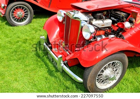 NOTTINGHAM, UK - JUNE 1, 2014: Close up of a rare MG red vintage car for sale in Nottingham, England. - stock photo