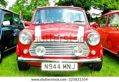 NOTTINGHAM, UK. JUNE 1, 2014: Frontal view of a red Mini Cooper vintage car for sale in Nottingham, England. - stock photo