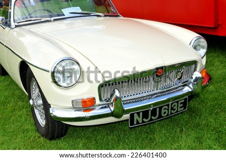 NOTTINGHAM, UK - JUNE 1, 2014: Frontal view of a white MG (Morris Garages) vintage car for sale in Nottingham, England. - stock photo